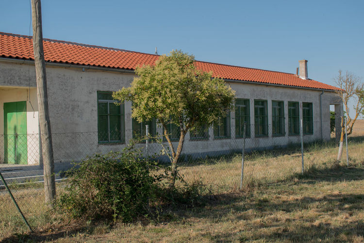 Exterior of abandoned building against clear sky