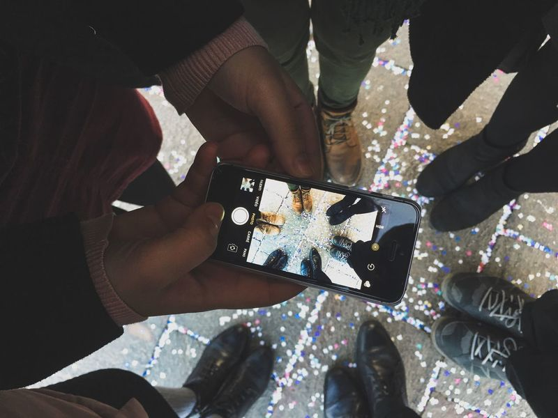 Capturing the moment Picture In Picture Frame In Frame IPhone Capture Feet Real People Human Hand Men Holding Human Body Part Leisure Activity Women Two People Lifestyles Close-up Wireless Technology Day Technology Friendship Indoors  Adult People