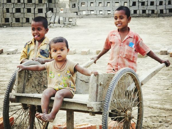 Growing up playing... Children finds play while their parents work at brick factory