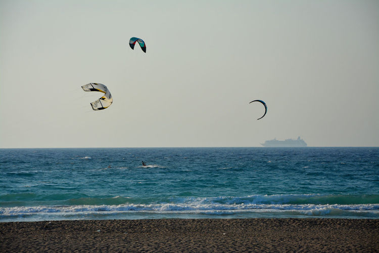 Beach Clear Sky Full Length Horizon Over Water Kiteboard Kiteboarding Leisure Activity Lifestyles Nature Sea Seascape Sky Unrecognizable Person Water