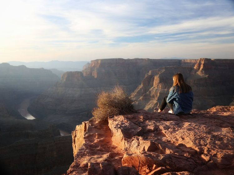 Lonely Only Women One Woman Only One Person Rock - Object Outdoors People Nature Travel Destinations Vacations Landscape Beauty In Nature Young Women Las Vegas NV Grand Canyon National Park Grand Canyon West Rim Trail West Rim Colorado River Nature Tranquility Beauty In Nature Lost In The Landscape