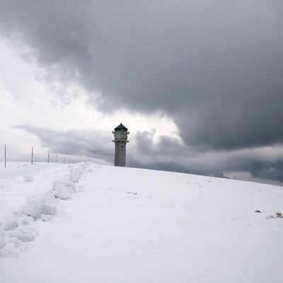 Hiking destination Snow Cold Temperature Winter Rural Scene Sky Landscape Lighthouse Deep Snow Snowcapped Mountain Frozen
