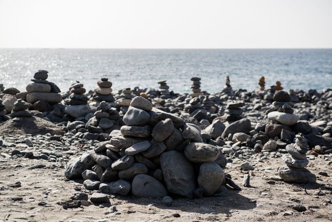 Art of stone balance, piles of stones on the beach. Tenerife, Canary Islands. Spain Atlantic Ocean Canary Islands Coastline SPAIN Tourist Attraction  Arrangement Art Balance Beach Coast Coastal Feature Concept Harmony Heap Of Stones Pebble Stones Pile Sculptures Sea Seaside Stack Of Stones Stacked Stones Stones Tenerife Tenerife Island Volcanic