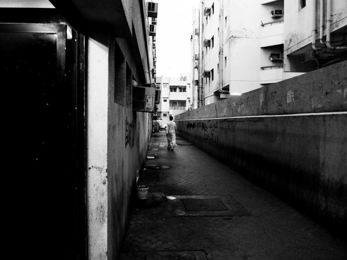Alone StreetLife_Award Alley Architecture Black And White Blackandwhite Photography Building Building Exterior City Diminishing Perspective Dubai, Footpath Monochrome monochrome photography Outdoors Residential District Streelight Street Streetphoto_bw Streetphotography Uae,abudhabi Walking