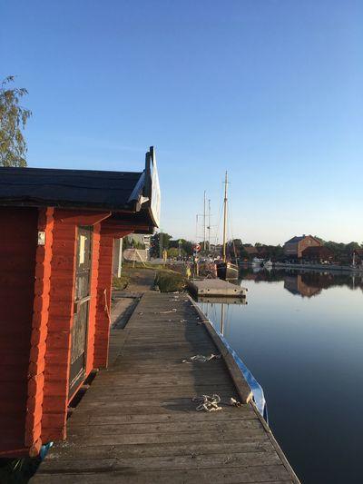 Pier amidst buildings against clear sky
