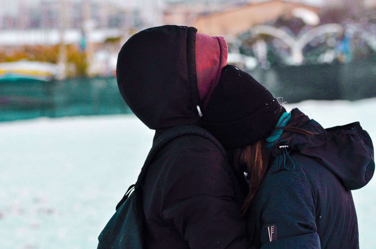 winter, jacket, real people, warm clothing, cold temperature, one person, knit hat, outdoors, focus on foreground, backpack, snow, day, leisure activity, lifestyles, women, nature, close-up, sky, people