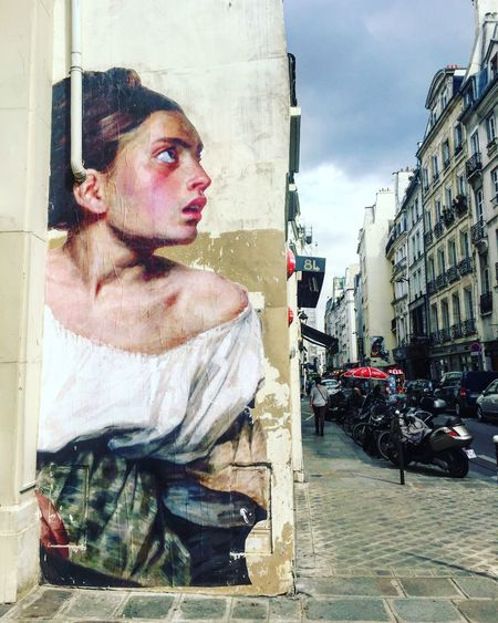 Walls of Paris serve as canvas Girl Painting Jan Vermeer Style Street Art Streetart/graffiti Vermeer Vermeer Style Wall Art Wall Painting Wall Picture Walls Of Paris Watch The Walls ParisStreet