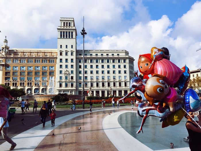 Plaza Catalunya in Barcelona Europe Street Urban City Catalonia SPAIN Plaça Catalunya Barcelona Balloons Architecture Building Exterior Cloud - Sky Sky Built Structure City Group Of People Outdoors Real People Building City Street
