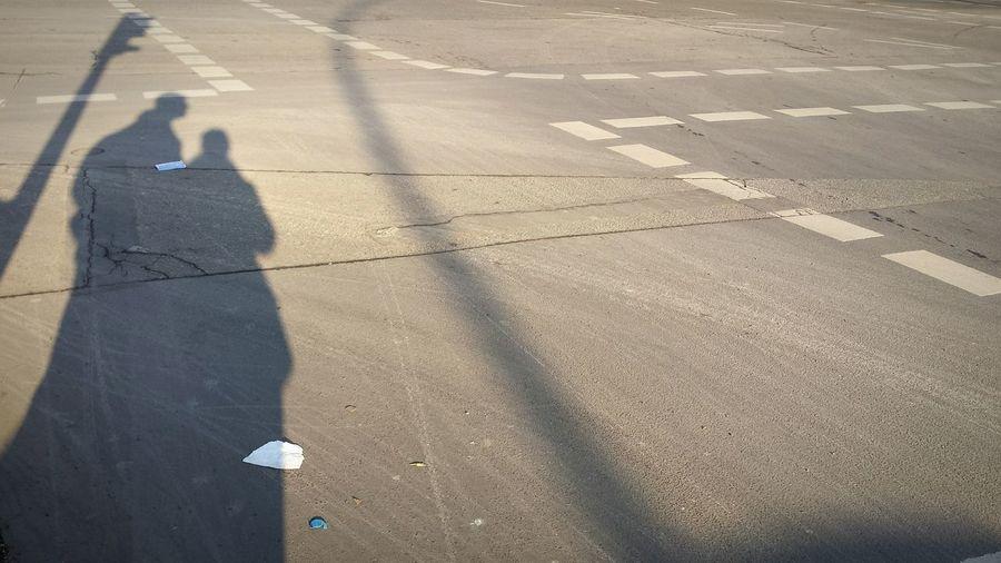 High angle view of people shadow on street