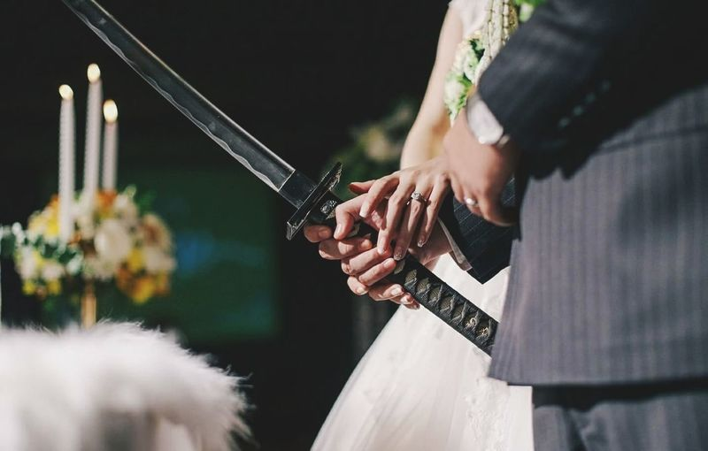 Katana cut cake ( wedding day ) Adult Arts Culture And Entertainment Only Women People Outdoors Weapon Standing Young Adult First Eyeem Photo