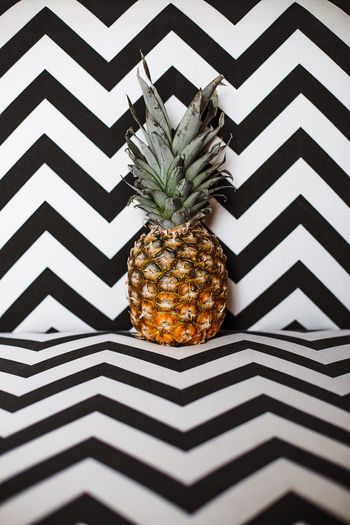 Close up of pineapple on zigzag pattern