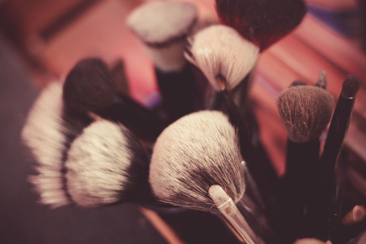 Cloes-up of make-up brush on table
