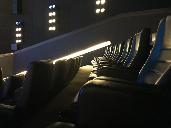 MOVIE Chair Cinema Chairs Cinema Illuminated Indoors  Transportation No People Seat Mode Of Transportation Night In A Row Close-up Architecture Light - Natural Phenomenon Empty Arts Culture And Entertainment