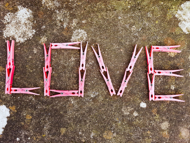 The word Love written with Pink clothes pegs on a stone background. Text Outdoors Communication No People Day Close-up EyeEmNewHere Artphotography Artphoto Smartphonephotography My Smartphone Life Samsung Galaxy S7 Edge Relationships Valentine's Day  Romantic Pictures Laundry Pegs Housework Affection Millennial Pink