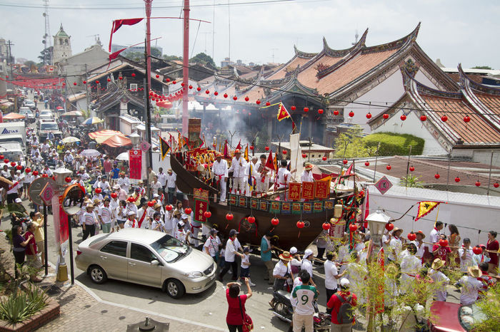 "The Wangkang procession is a significant festival held once every uncertain period, sometimes decades, in Melaka, Malaysia. It is an age-old tradition of the Hokkien community and it is believed to cleanse a place of evil spirits. The highlight is the majestiv barge that proceeded on a few kilometers journey pulled by devotees where evil spirits are ""taken aboard"" before they are set ablaze at the end of procession. Barge Belief Boat Chinese Crowd Devotee Devotees Devotion Festival Malacca Malaysia Melaka Parade Procession Religion Temple Wangkang Carnival Crowds And Details"