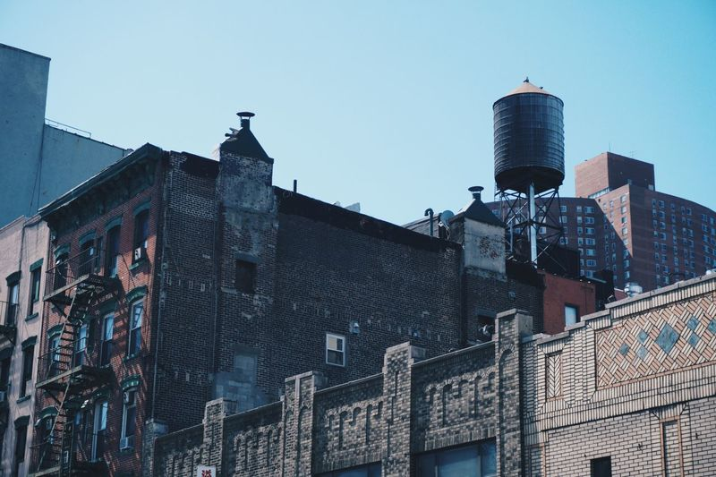 EyeEm Selects Building Exterior Built Structure Architecture Sky Building Low Angle View Day No People Wall - Building Feature Brick Wall Street Residential District Street Light Graffiti Clear Sky Outdoors Lighting Equipment Nature City Wall