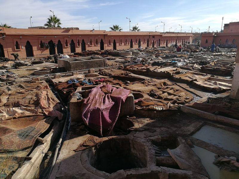 tannery in Marrakesh Container Dye Leather Manual Worker Manufacturing Medina Tannery Tanning Traditional Culture