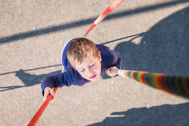 High angle view of boy playing on playground