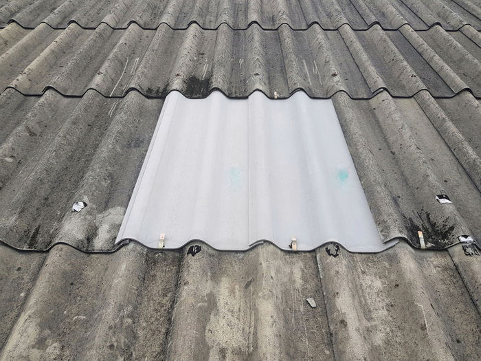 High angle view of roof tiles on building