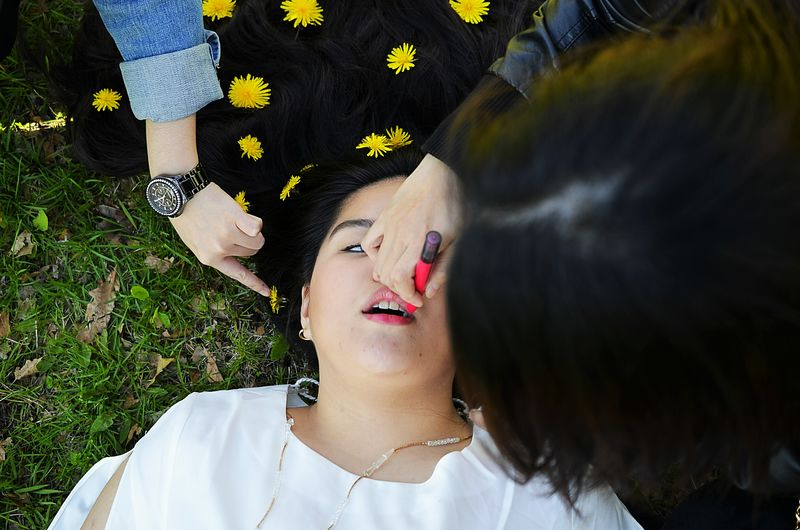 Young Woman Preparing For Photo Shooting