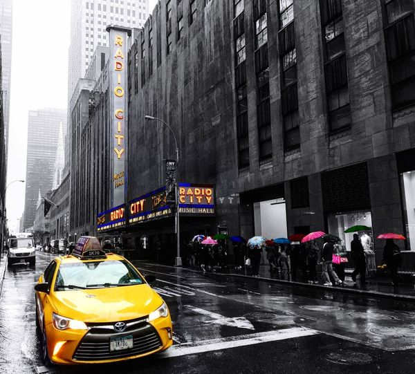 City City Street Traffic Taxi Yellow Taxi Transportation City Life Building Exterior Street Car Mode Of Transport Architecture Travel Destinations Land Vehicle Built Structure Road Day Large Group Of People People Skyscraper New York City Colors Color Splash