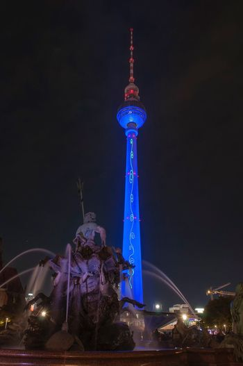 Low angle view of illuminated statue at night