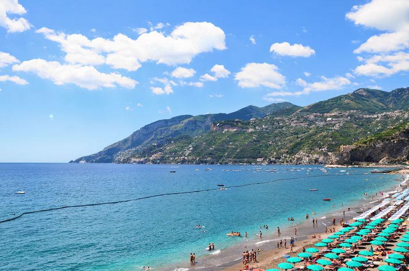 TOURISTS ON IDYLLIC BEACH IN ITALY