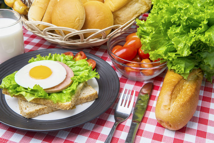 Bowl Bread Breakfast Checked Pattern Egg Food Food And Drink Freshness Fried Fried Egg Fruit Healthy Eating Herb Kitchen Utensil Lettuce Meal No People Plate Ready-to-eat Sandwich Snack Table Tomato Vegetable Wellbeing