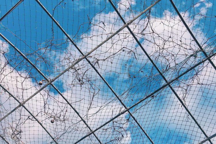 Full frame shot of blue sky seen through glass