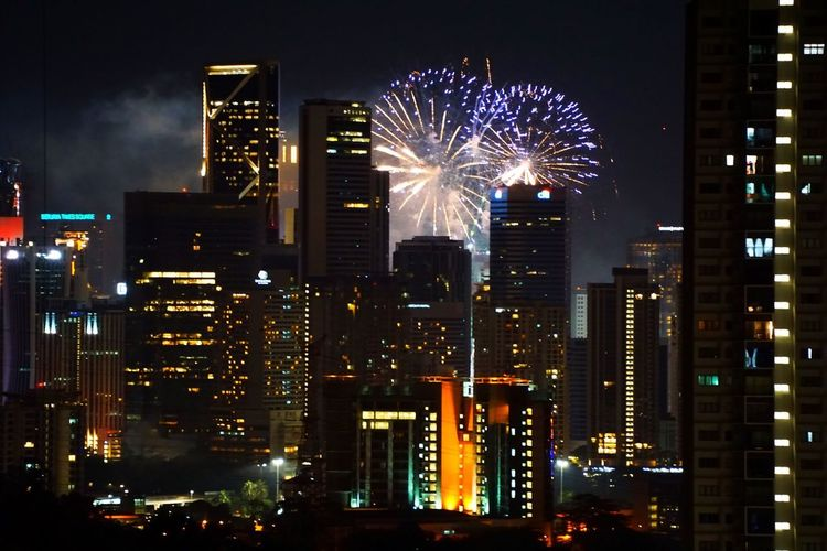 New year fireworks never cease to amaze the viewers Illuminated Night Building Exterior Built Structure Architecture Building City Firework Cityscape Exploding Arts Culture And Entertainment Firework Display Celebration