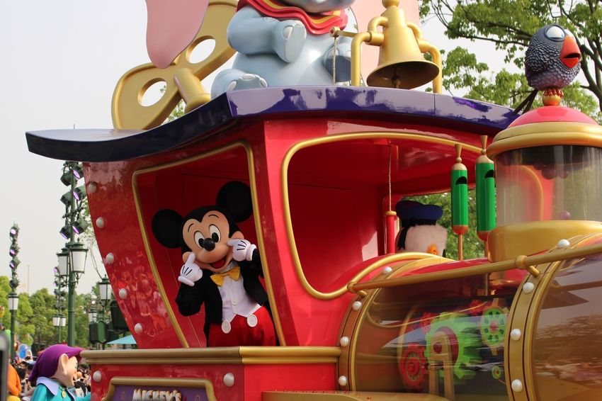 Two People Amusement Park Fun Day Outdoors Enjoyment Red Real People Childhood Togetherness Sitting Carousel Tree Clown Disneyland Shanghaidisneyland Disney Shanghaidisneyresort Micky Mouse