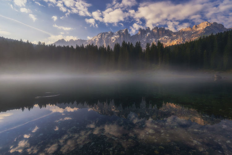 CArezza lake in Italy Carezza Lake Cloud - Sky Water Reflection Beauty In Nature Tranquility Lake Tranquil Scene Scenics - Nature Sky Tree No People Plant Idyllic Nature Non-urban Scene Mountain Fog Forest Reflection Lake Dolomites, Italy