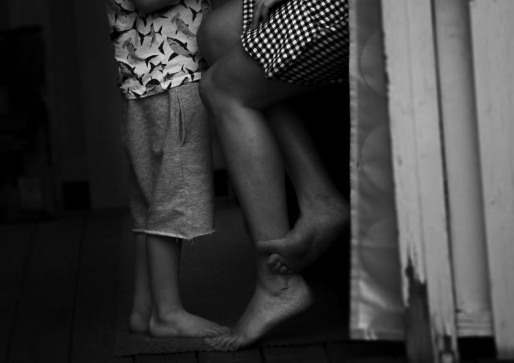 Adult Barefoot Bed Blackandwhite Boys Childhood Day EyeEm Best Shots EyeEmNewHere Human Body Part Human Hand Human Leg Indoors  Lifestyles Love Low Section Monochrome Mother And Son People Portrait Real People Sitting Standing Postcode Postcards EyeEmNewHere