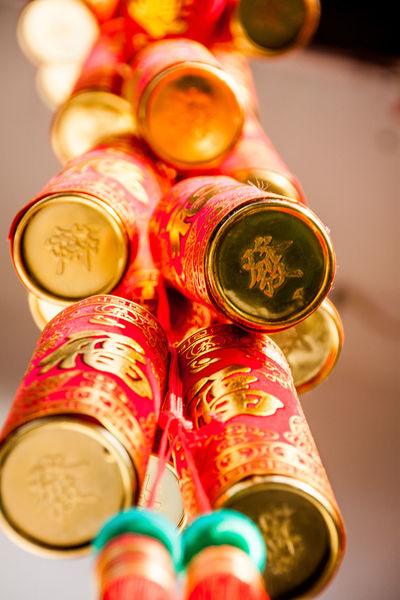 fire crackers seen in Nanjing, used during chinese new year to scare the monsters away so they won't disturb the village ASIA BANGER Explosion Fireworks Monster New Year Salute Tradition China Chinese Close-up Day Gold Colored Loud No People Red Color Tale