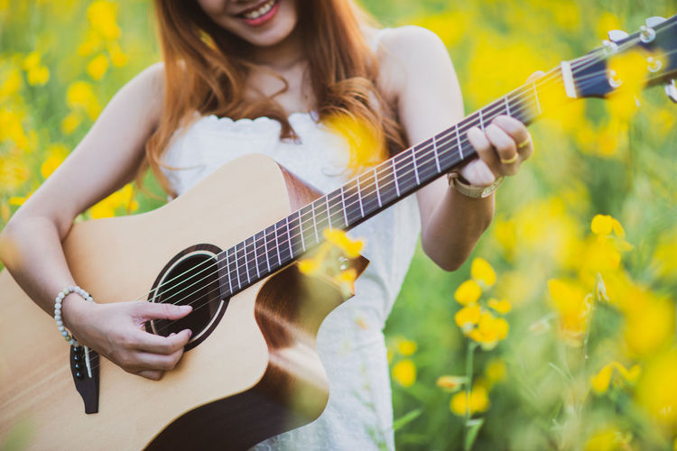 Young woman holding guitar