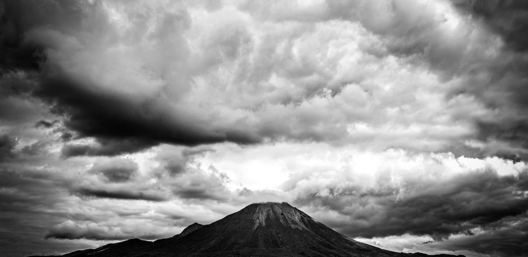 Cloud - Sky Sky Scenics - Nature Beauty In Nature Mountain Tranquil Scene Non-urban Scene Tranquility Environment Nature No People Landscape Idyllic Overcast Day Outdoors Cloudscape Volcano Land Ominous Power In Nature Mountain Peak Volcanic Crater