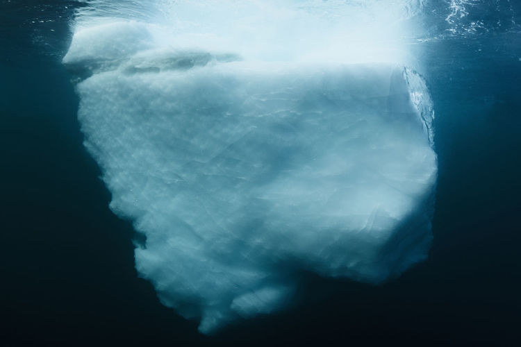 Underwater image of an iceberg in Scoresby Sund fjord, the worlds largest fjord, east coast of Greenland. Abstract Photography Global Warming Greenland Ice Melting Shape Water Reflections Abstract Arctic Arctic Monkeys Blue Climate Change Fjord Glacier Glacier Ice Iceberg Iceberg - Ice Formation No People Ocean Scoresby Sound Seascape Structure Underwater underwater photography Water
