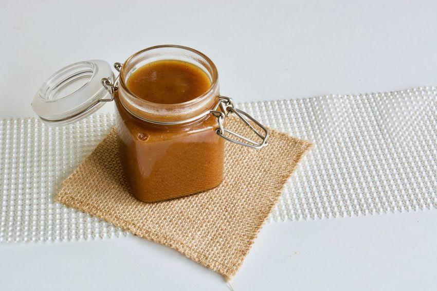 Tasty apple jam in the glass jar on the white table Food And Drink Indoors  Food Studio Shot Still Life No People Refreshment High Angle View Cup White Background Freshness Table Close-up Coffee Napkin Mug Wellbeing Crockery Jam Apple Apple Jam