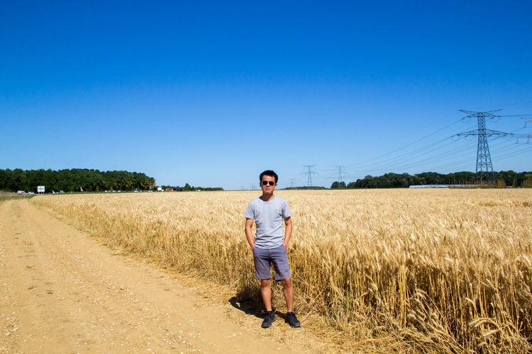 Full length portrait of man on field against sky
