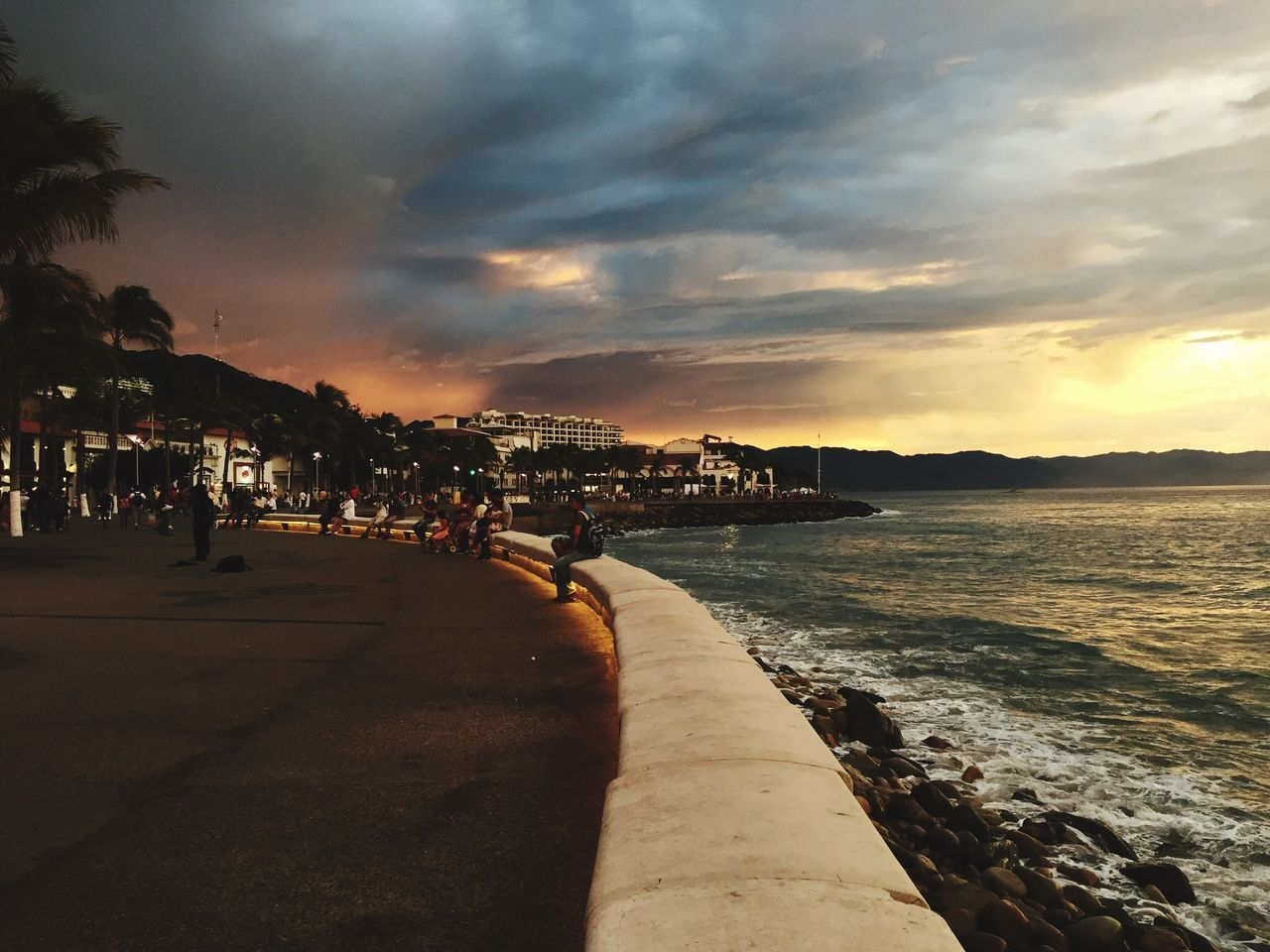 sky, water, cloud - sky, architecture, sea, beach, sunset, nature, building exterior, city, built structure, land, beauty in nature, scenics - nature, group of people, incidental people, outdoors, people, idyllic