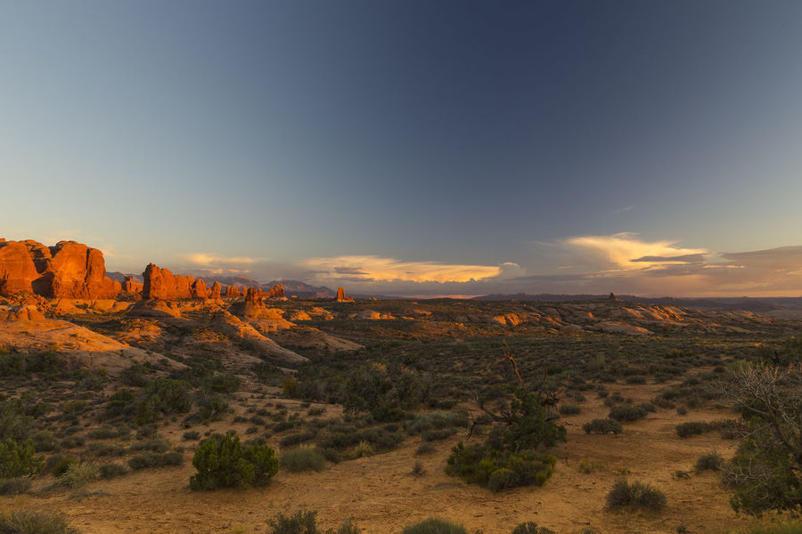 Breathtaking panoramic view of Arches National Park, Utah, at sunset, with famous red rocks in the background Arches National Park Utah USA Travel Destinations Scenics - Nature Landscape Tranquil Scene Sunset Semi-arid Beauty In Nature Arid Climate Red Rocks  Immense Desertic Iconic Famous Place Tourist Attraction  Red Earth Landscape Panoramic View