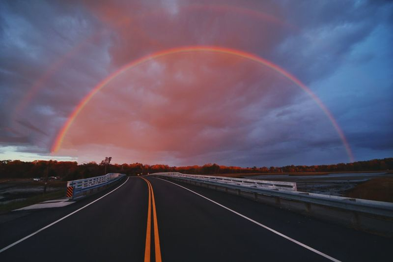 Driving through a Double Rainbow Arch Pink Sky Sunset Storm Clouds Archway Arch Rainbow Road Road Marking The Way Forward Double Rainbow Cloud - Sky Transportation Sky Scenics No People Nature Tranquility Multi Colored Beauty In Nature Outdoors Be. Ready. Be. Ready. Capture Tomorrow