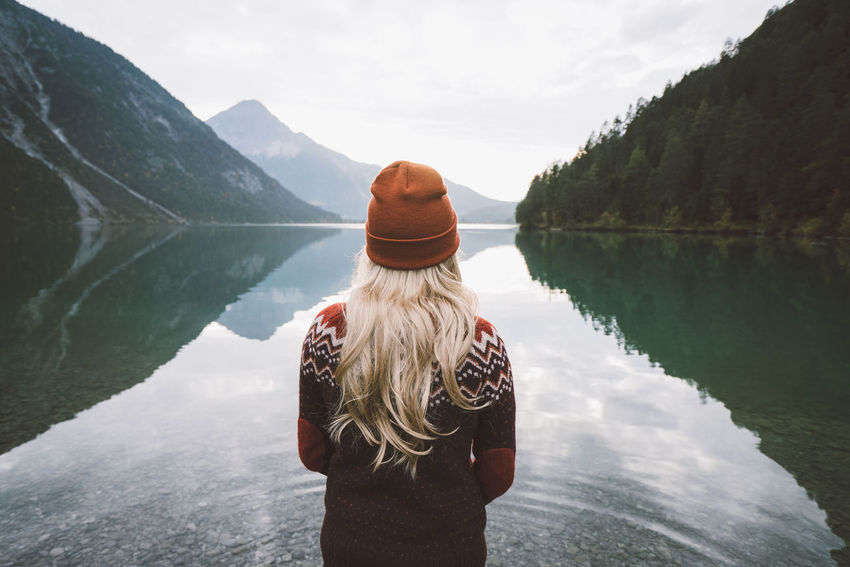 Water Rear View Lake Leisure Activity Real People One Person Scenics - Nature Beauty In Nature Lifestyles Women Day Mountain Nature Tranquility Sky Tranquil Scene Standing Adult Non-urban Scene Hair Looking At View Outdoors Hairstyle Plansee
