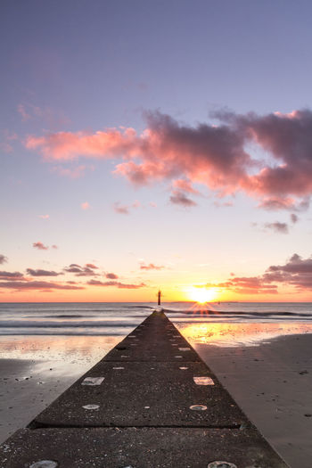 An amazing winter sunset on the small german island Borkum. Beach Beauty In Nature Borkum Coast Day Deutschland Dramatic Sky Germany Horizon Over Water Island Nature No People Outdoors Reflection Sand Sea Sky Summer Sunset Water Wide Angle