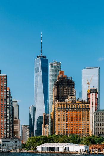 Modern buildings against clear blue sky