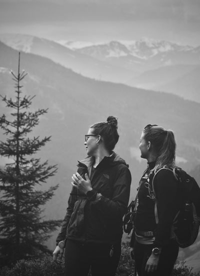 Female hikers looking at mountain