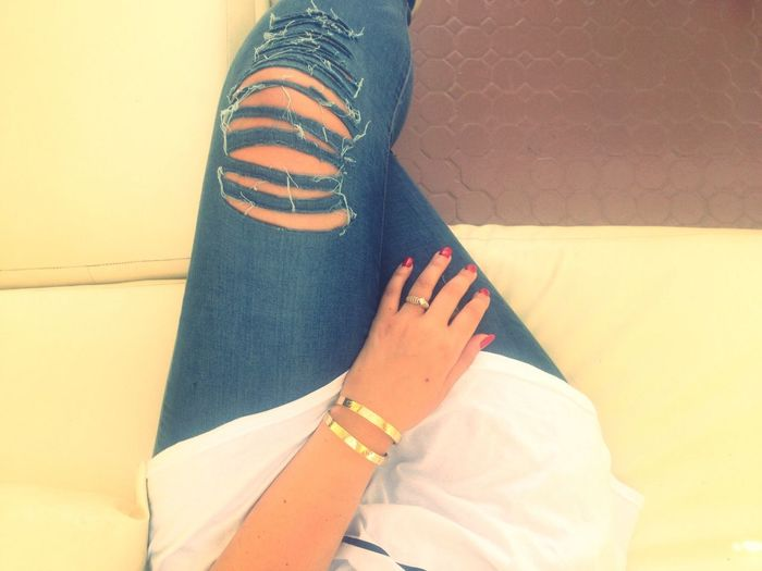 Shredded jeans, red nails and my Cartier lovebracelets.
