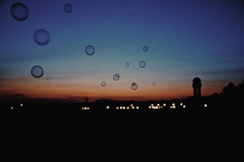 Bubbles The Week on EyeEm Berlin Photography Berlin Sky Silhouette Nature Sunset No People Transparent Water Glass - Material Drop Dusk Outdoors Wet Environment Illuminated Orange Color Beauty In Nature Landscape Glass