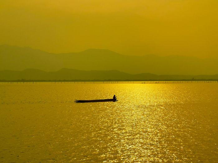 Fishermen's Life Fisherman Boat Fishing Boat Fisherman Water Rowing Nautical Vessel Oar Yellow Sunset Silhouette Kayak Sky