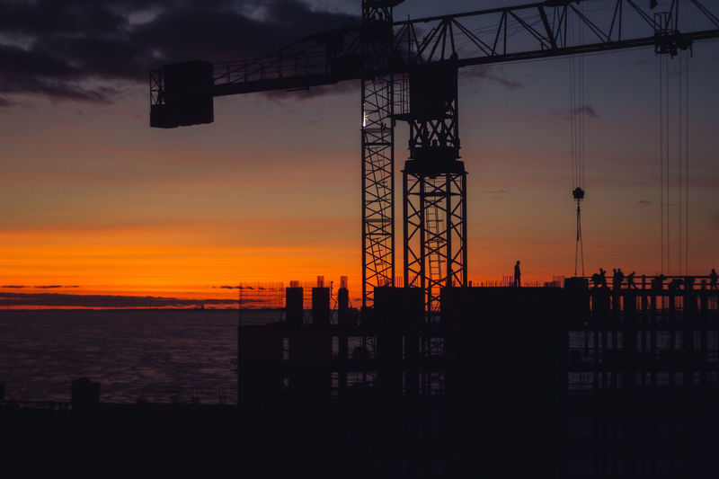 Sunset Sky Silhouette Water Sea Orange Color Architecture Built Structure Industry Machinery Nature Construction Industry Cloud - Sky Crane - Construction Machinery Construction Site Outdoors No People Beauty In Nature Scenics - Nature Construction Equipment My Best Photo